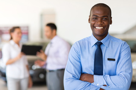 african american ethnicity: handsome african car salesman looking at the camera Stock Photo