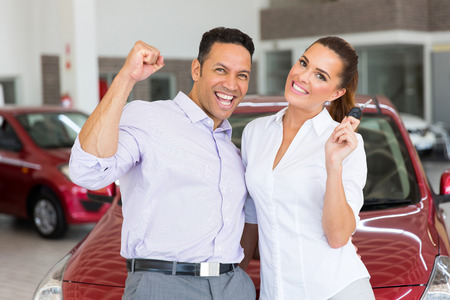bought: excited couple just bought a new car from dealership