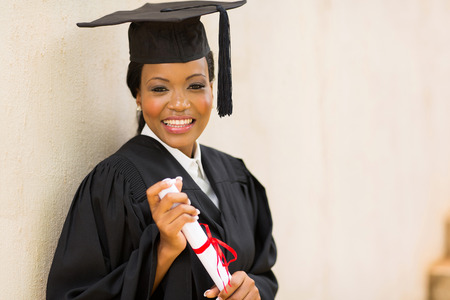 attractive african female graduate holding diploma photo