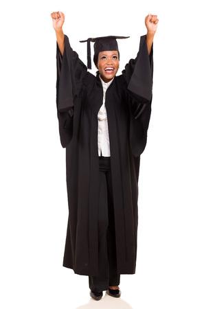 joyful african american female university graduate arms up isolated on white