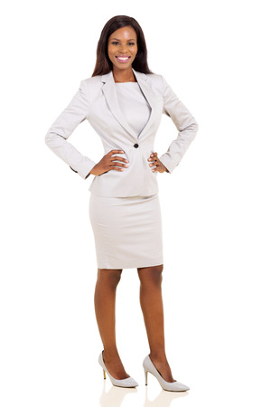 african american woman smiling: confident young african american businesswoman on white background Stock Photo