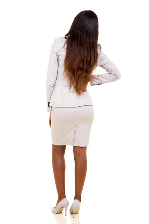 rear view of african woman having backache isolated on white background photo