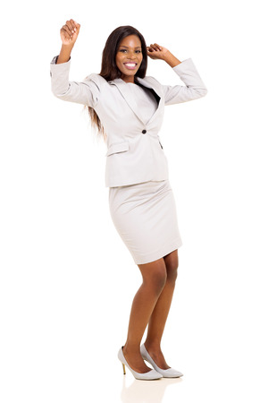 excited business woman: excited young african woman dancing over white background Stock Photo