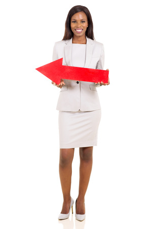 pretty african businesswoman with red direction arrow on white background photo