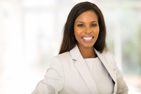 close up portrait of young afro american businesswoman in office Banco de Imagens