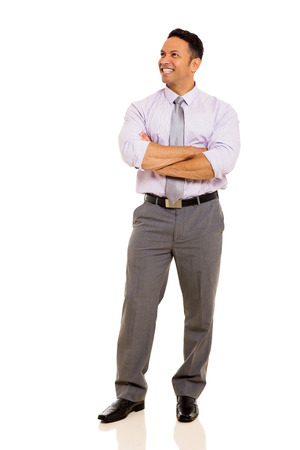 arms folded: happy mature business man with arms folded isolated on white