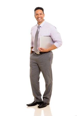 mid age: handsome mid age business executive holding laptop Stock Photo