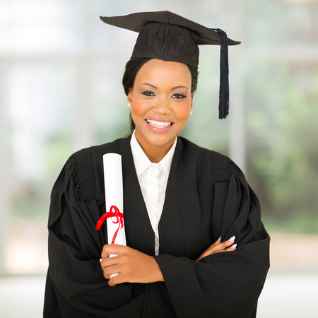 beautiful female african graduate with arms crossed photo