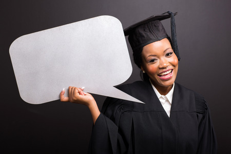 young afro american graduate with blank text bubble isolated on black photo