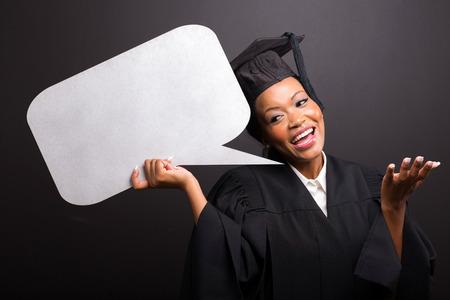 gorgeous african female university graduate holding speech bubble photo