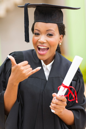 cheerful young african female graduate doing call me sign photo