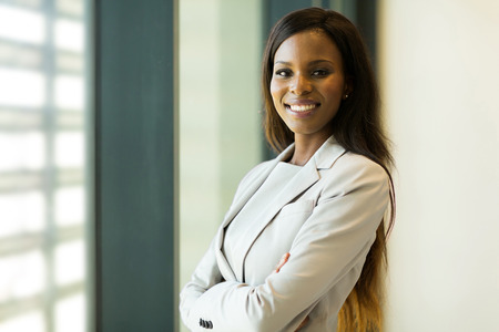 african business: portrait of young pretty african american businesswoman in office
