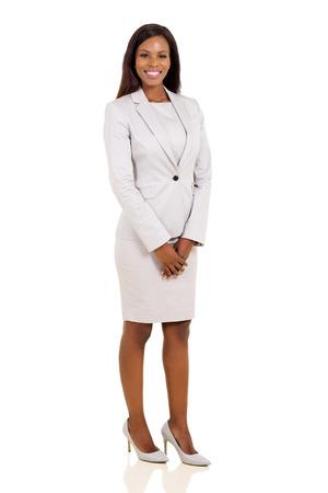 persona de pie: moderna mujer de negocios africano aislado en fondo blanco Foto de archivo
