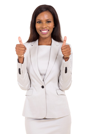 pretty african american businesswoman giving thumbs up on white background photo