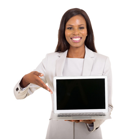 happy african businesswoman presenting black laptop screen on white background Stock Photo