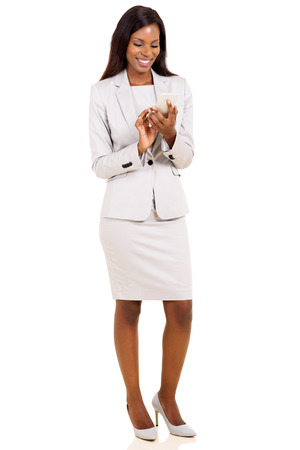 text message: happy african businesswoman texting on her smart phone