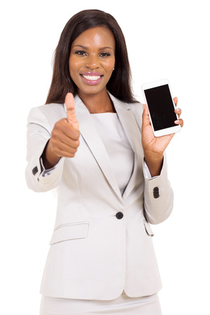 holding cell: pretty businesswoman holding cell phone and giving thumb up Stock Photo