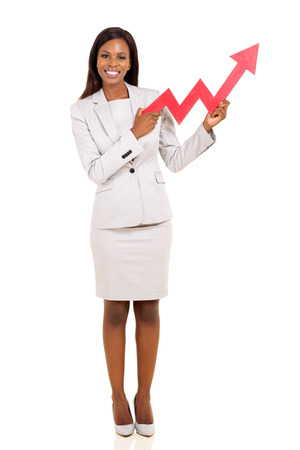 growing business: happy african american businesswoman holding stock arrow isolated on white