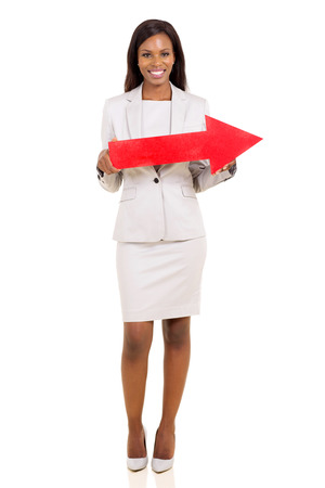 afro american businesswoman holding red arrow isolated on white photo