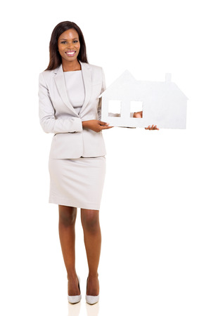 young african american woman holding paper house isolated on white photo