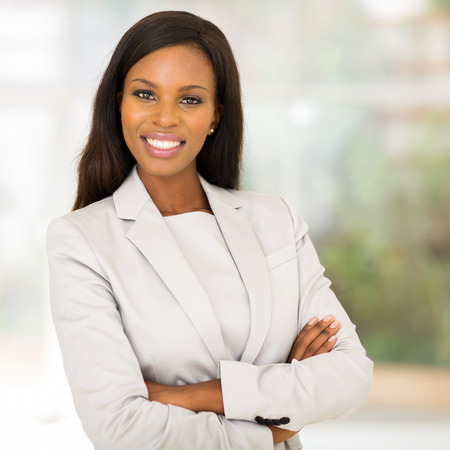 arms folded: gorgeous african business woman with arms folded in modern office