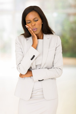 ethnic attire: unhappy african american woman having toothache