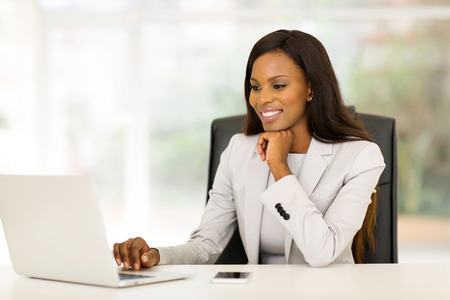 beautiful laptop: portrait of beautiful young african business woman in office