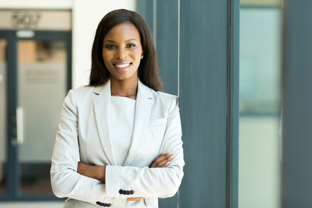 close up portrait of young business woman in modern office