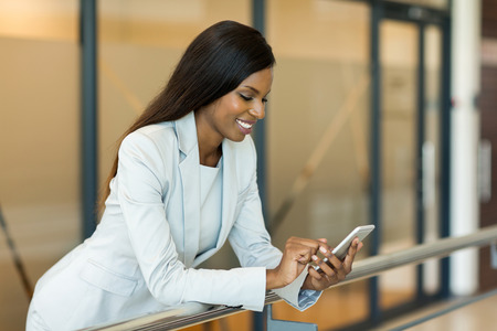 african american businesswoman: professional young african career woman using smart phone Stock Photo