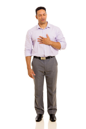 sick person: mid age man having chest pain isolated on plain background