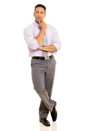 mid age: thoughtful mid age businessman standing on white background Stock Photo