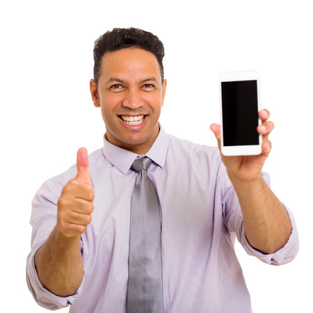 holding cell: happy middle aged man holding cell phone and giving thumb up