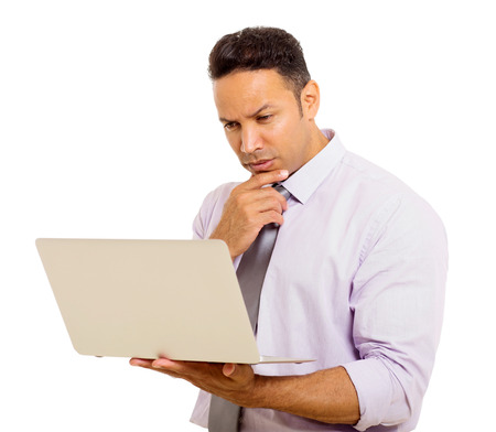 mid age: handsome mid age businessman reading email on his laptop