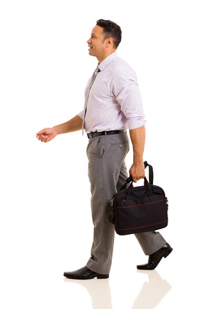 people walking: side view of businessman holding a bag walking isolated on white