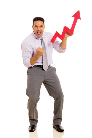 mid age: excited mid age businessman holding stock arrow on white background Stock Photo