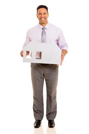 handsome mid age businessman holding white paper house photo