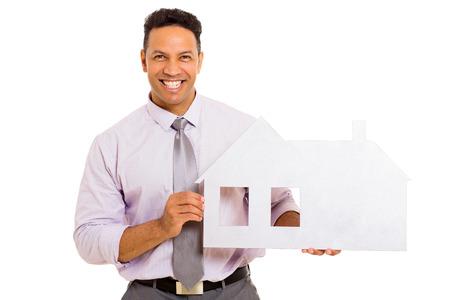 portrait of happy man showing house symbol on white background photo