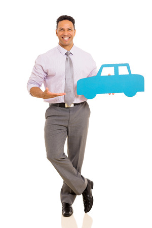 mid age: cheerful mid age man presenting paper car isolated on white background