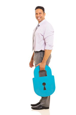 good looking man: smiling mid age man holding security padlock isolated on white background