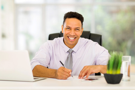 business executive: good looking mid age business executive working in office Stock Photo