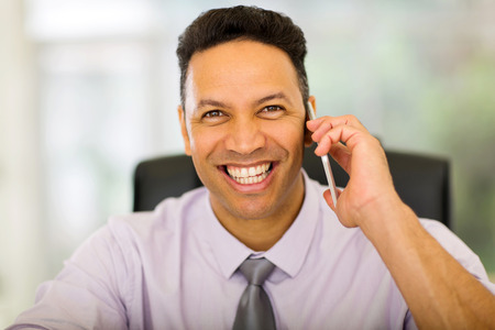 good looking: good looking businessman talking on smart phone Stock Photo