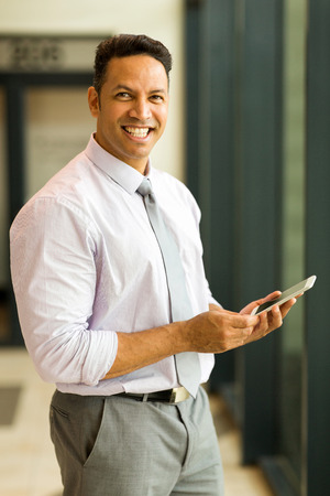 mid age: good looking mid age business man holding smart phone Stock Photo