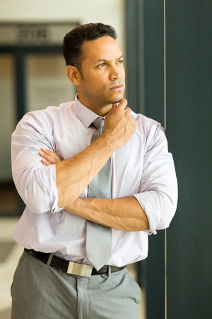 thoughtful businessman in modern office