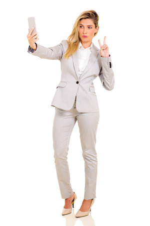 working model: pretty businesswoman taking a selfie with smart phone camera Stock Photo