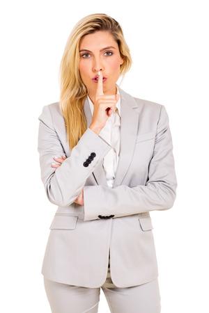 shhh: beautiful businesswoman saying shhh isolated on white background Stock Photo