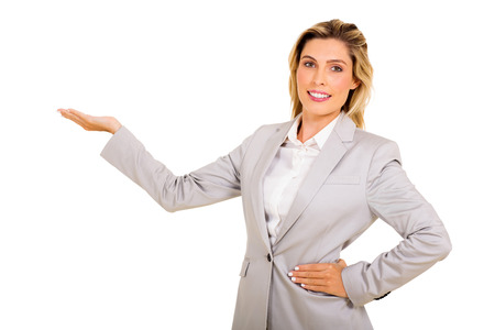 white suit: happy young businesswoman presenting on white background Stock Photo