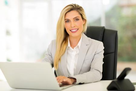 beautiful young businesswoman using computer Stock Photo