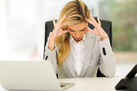 overworked businesswoman sitting in office