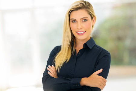 corporate office: attractive corporate worker standing in modern office