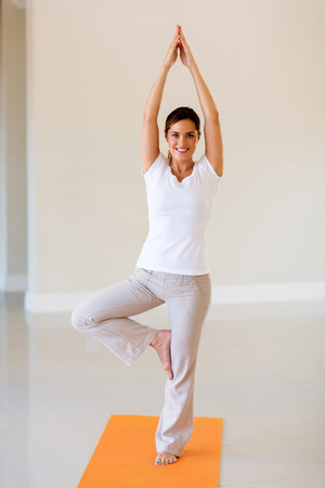 happy healthy woman: happy healthy woman doing yoga exercise Stock Photo